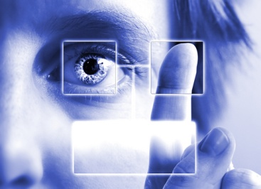A person using an eye scan and fingerprint recognition system.