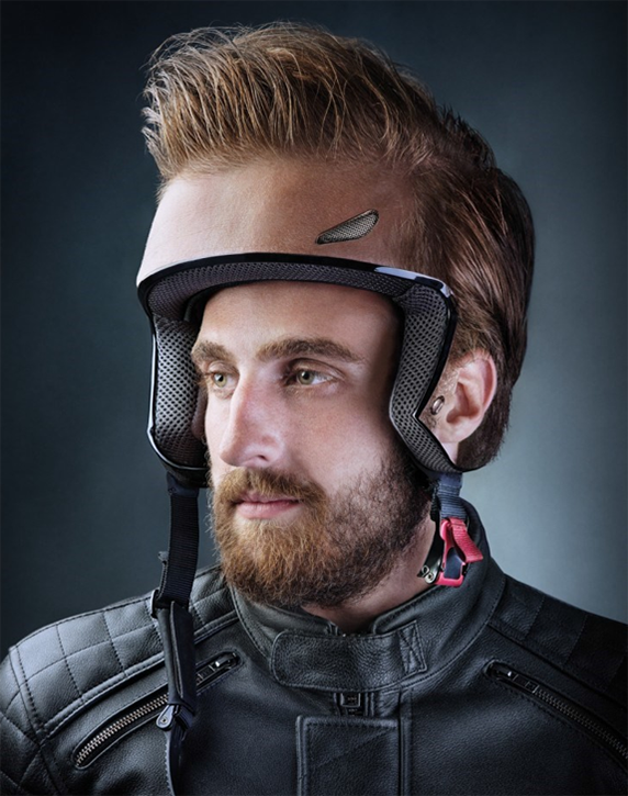 Man wearing skin-toned motorcycle helmet